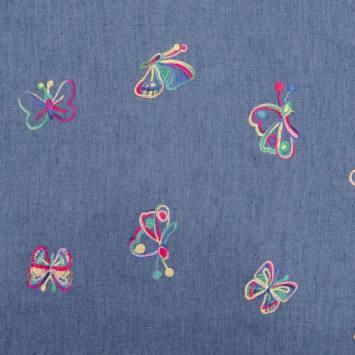 Tissu jean bleu clair papillon brodé