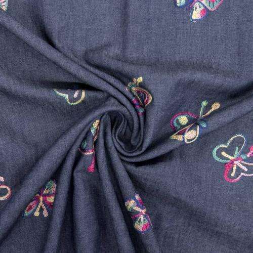 Tissu jean bleu foncé papillon brodé
