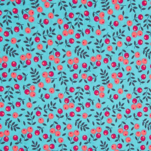 Popeline de coton turquoise motif baies rouges et orange