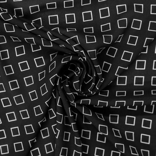 Mousseline crêpe noire motif carré blanc