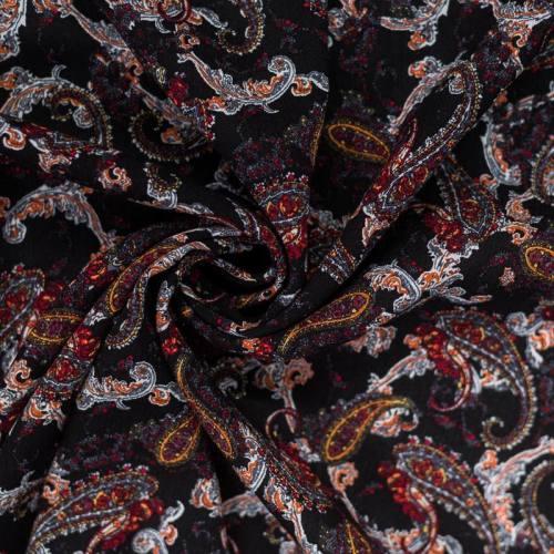 Tissu crêpe viscose noir motif cachemire rouge