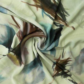 Mousseline verte impression effet plume brune et bleue