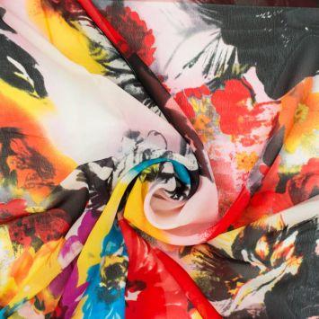 Mousseline multicolore motif fleurs nébuleuses