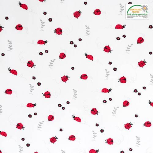 Popeline de coton blanche motif coccinelle