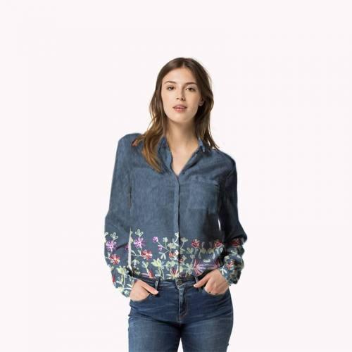 Tissu jean bleu foncé motif floral brodé
