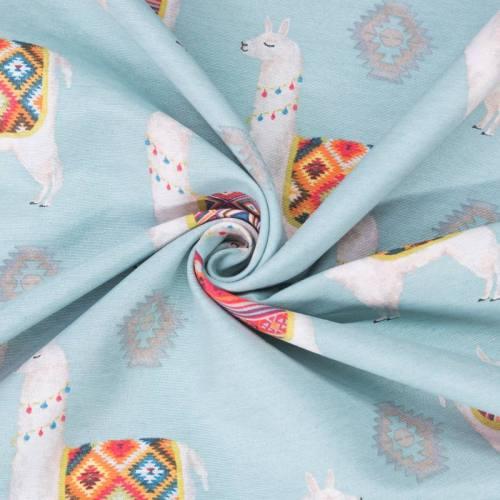 Toile polycoton bleu motif lama poncho
