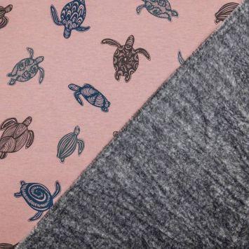 Tissu molleton rose motifs tortues envers polaire