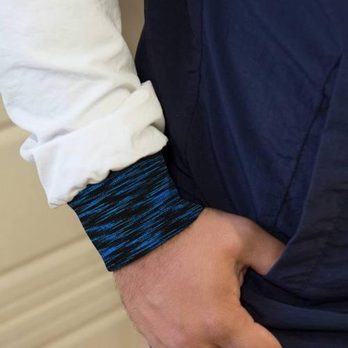 Tissu tubulaire bord-côte chiné noir et bleu fluo