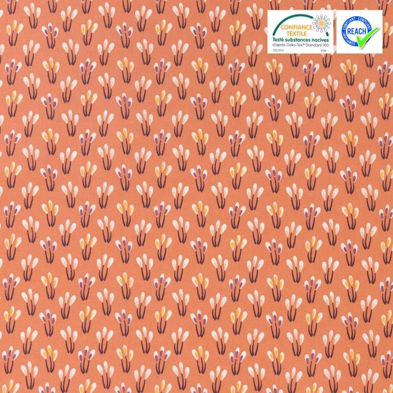 Coton enduit saumon motif fleurs papluma