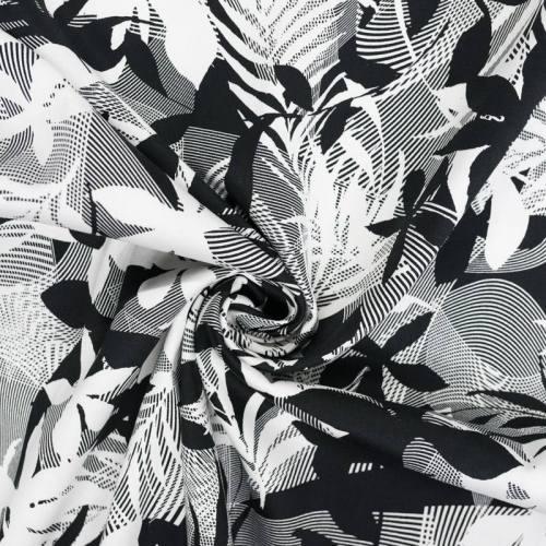 Satin de coton extensible noir motif feuilles et courbes blanches