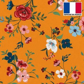 Tissu scuba orangé imprimé floral
