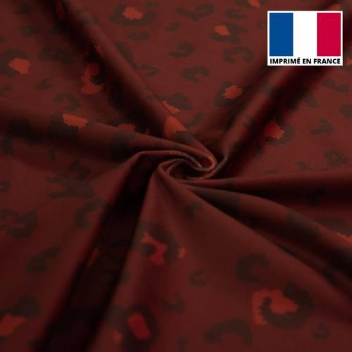 Velours d'habillement motif léopard bordeaux monochrome