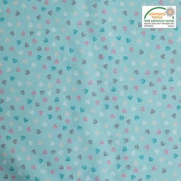 Popeline de coton bleu clair imprimée coeurs multicolores