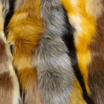 Fausse fourrure jaune zébrée