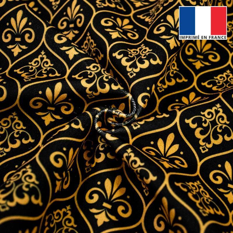 Velours noir motif ornements baroques jaune or