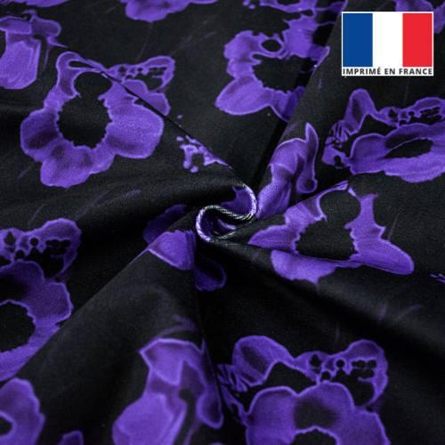 Velours ras noir motif fleur ultra-violet