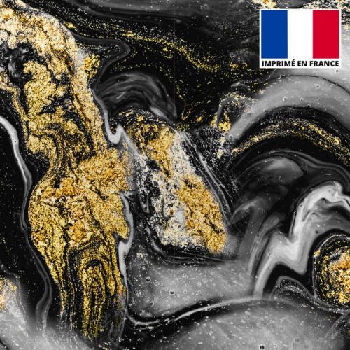 Lycra imprimé magma noir et poudre d'or
