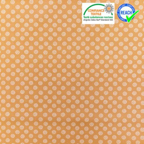 Coton caramel motif boule blanche