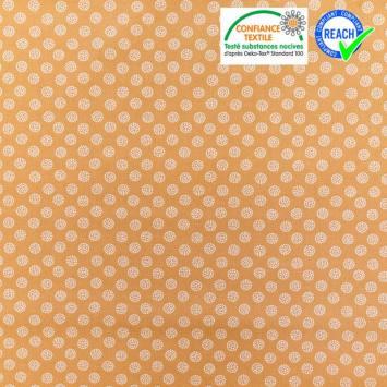 Coton ocre rouge motif boule blanche