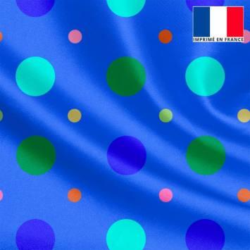 Tissu satiné bleu imprimé pois vert et bleu