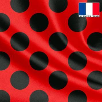 Tissu satiné rouge imprimé pois noir