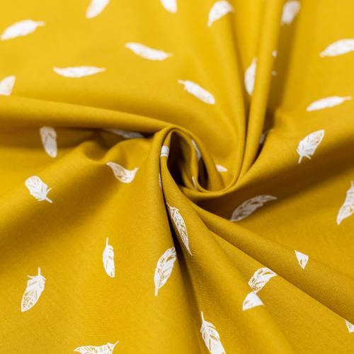 Popeline de coton ocre motif plume blanche