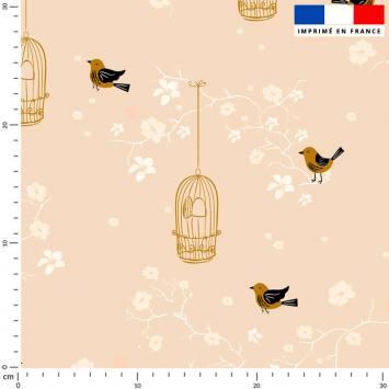 Fleur de cerisier et cage à oiseaux - Fond rose pêche