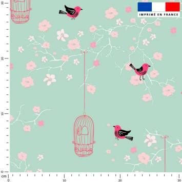 Fleur de cerisier rose et cage à oiseaux - Fond vert d'eau