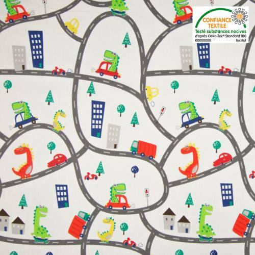 Popeline de coton blanc motif circuit de voiture et dinosaure Oeko-tex