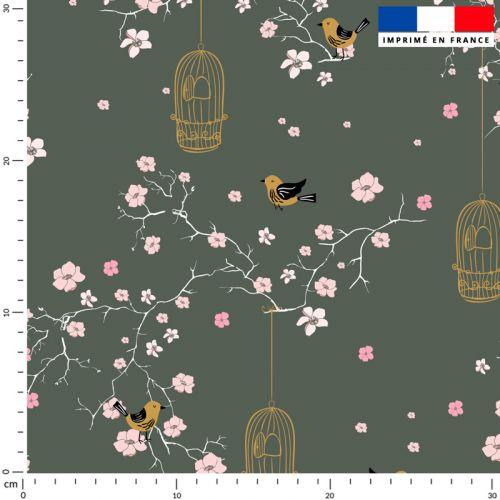 Fleur de cerisier rose et cage à oiseaux - Fond kaki