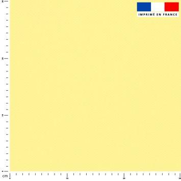 Tissu imperméable jaune pastel uni
