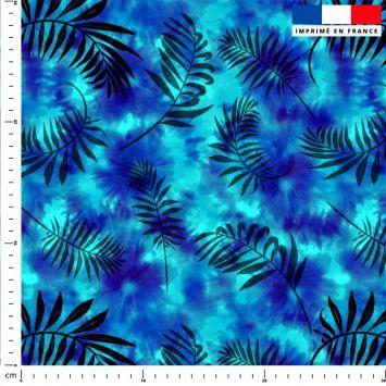 Tie and dye et palme effet aquarelle - Fond bleu azur