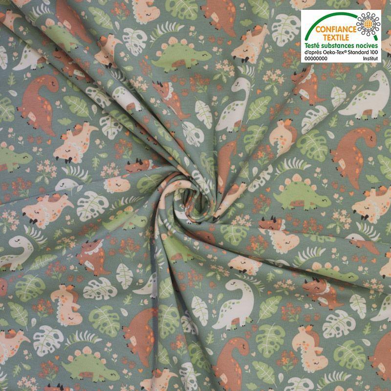 Jersey coton vert imprimé dino et feuille Oeko-tex