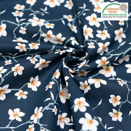 Coton bleu marine motif fleur d'amandier blanche