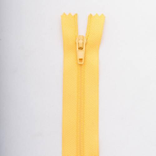 Fermeture 55 cm polyester non séparable jaune Col 104