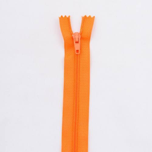 Fermeture 50 cm polyester non séparable orange Col 120