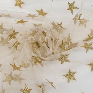 Tulle ivoire à étoiles dorées